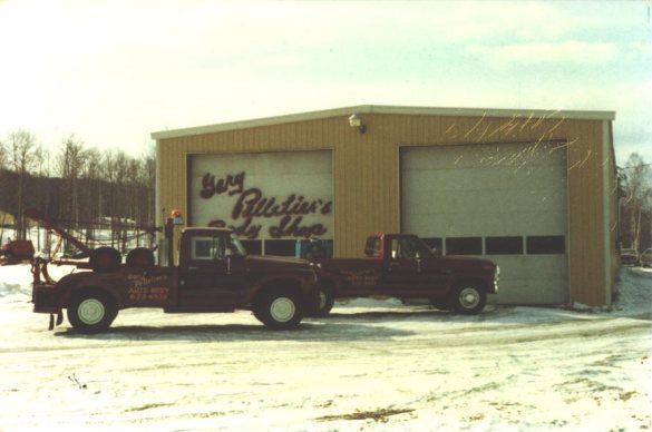 exterior of Pelletier's Body shop with truck in 1977